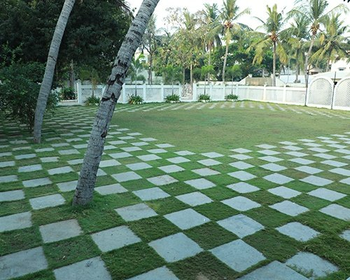 Large lawn surrounded with trees and greenery making it ideal outdoor wedding halls in chennai