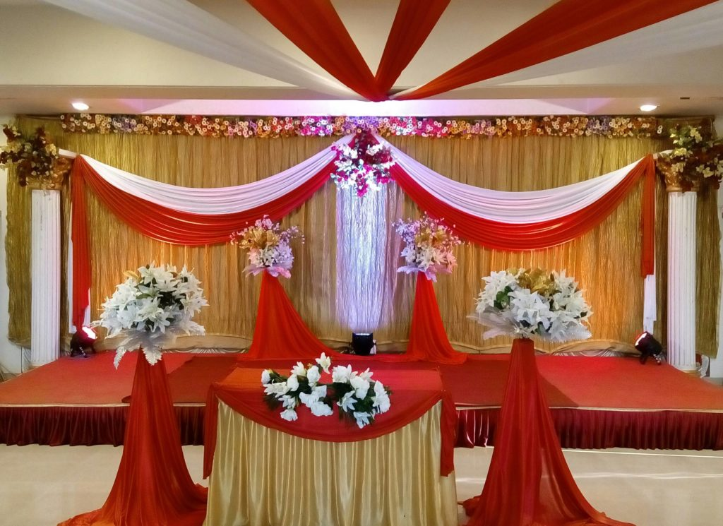 Wedding venue with beautiful flowers and lighting decoration